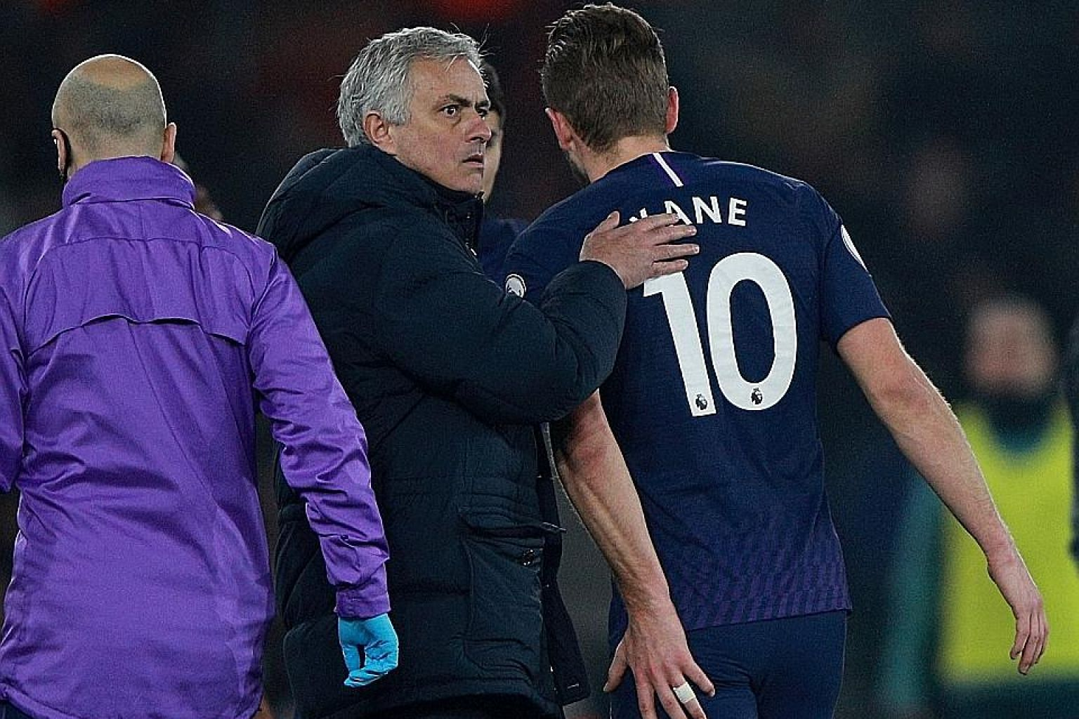 Tottenham Hotspur manager Jose Mourinho patting striker Harry Kane as he goes off injured during the 1-0 Premier League loss at Southampton on Jan 1. Yesterday, the club confirmed Kane had a torn hamstring. PHOTO: REUTERS