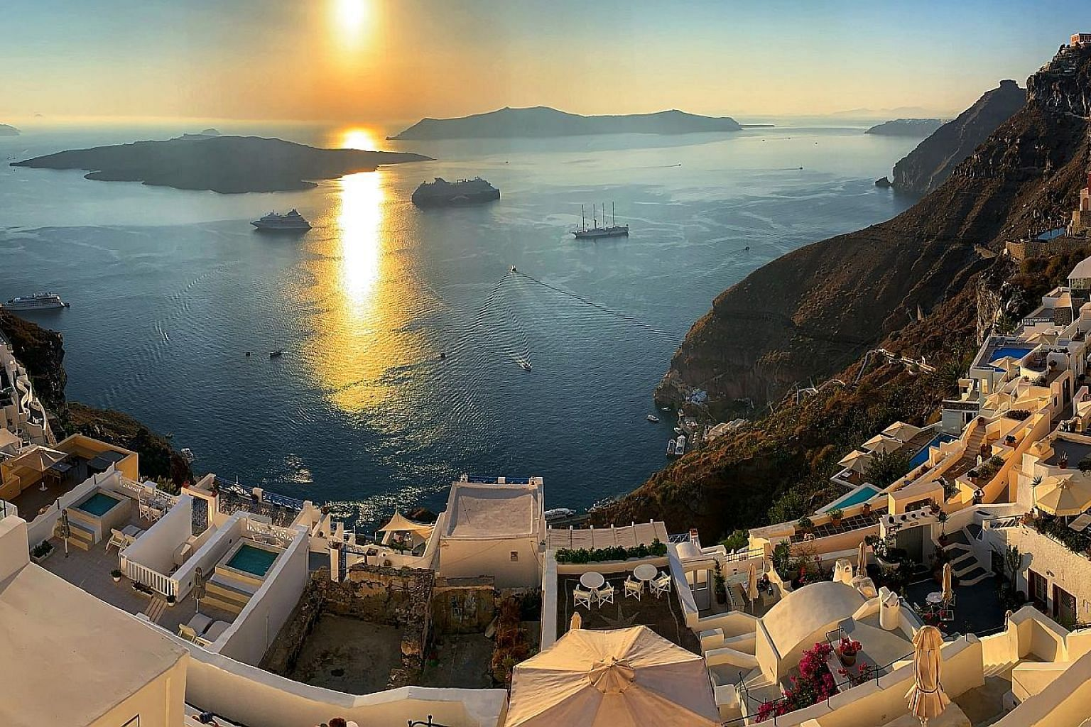 (Right) There is still an active volcano on a tiny island in the middle of Santorini's caldera and you can climb up for a 360-degree view. (Far right) A postcard-perfect sunset from Santorini's Fira village. (Above) Almost 2,000 years old, this build