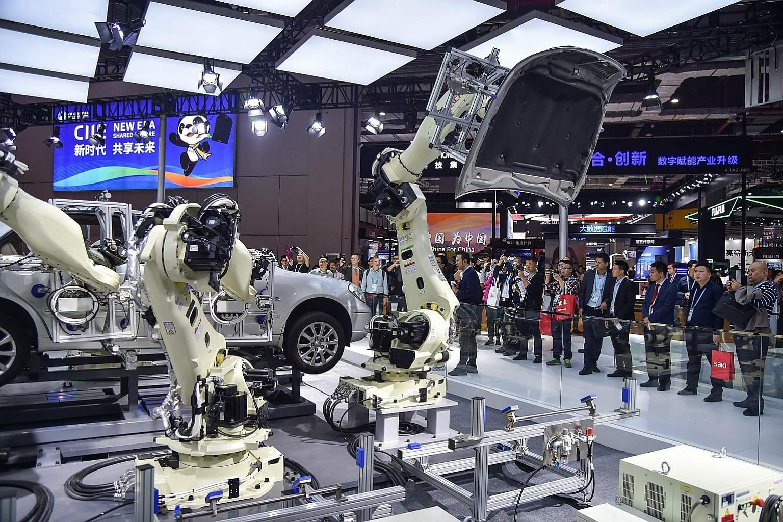 Robots assembling parts of a car at the China International Import Expo in Shanghai last November. With more research and development spending and an accelerated shift to automation, long-term investment themes like automation and robotics will stand