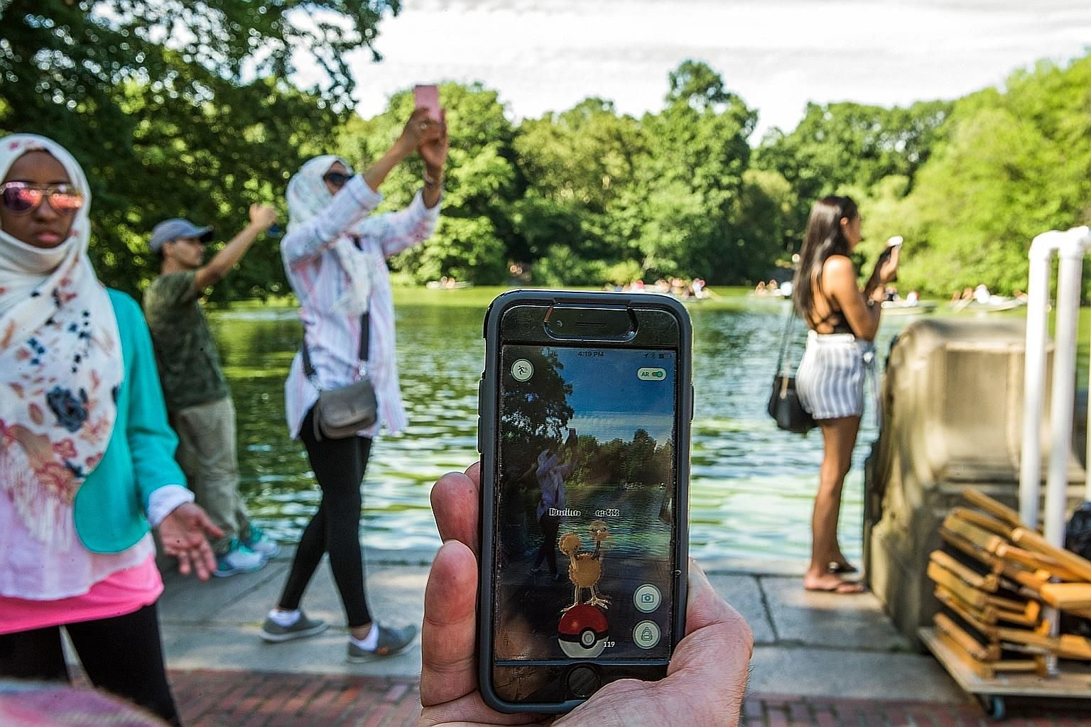 A user playing Pokemon Go - the augmented-reality game which fuses digital technology with the physical world - at New York's Central Park in 2016. After the app was available in Canada, the Canadian Armed Forces issued a public warning, urging civil