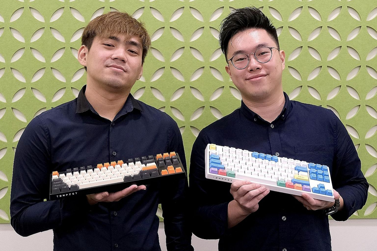 Local tech start-up Tempest co-founders Eric Heng (left) and Ben Hui with the brand's Kirin keyboards, which were launched last month. The third co-founder, Issac Yuen, was not at the photo shoot.