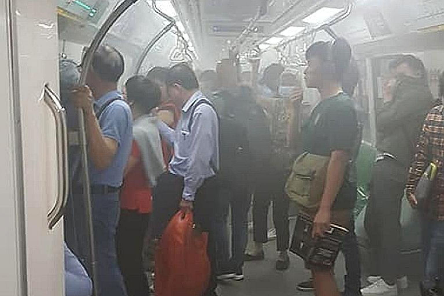 White smoke inside the cabin of the MRT train at Tanjong Pagar yesterday.