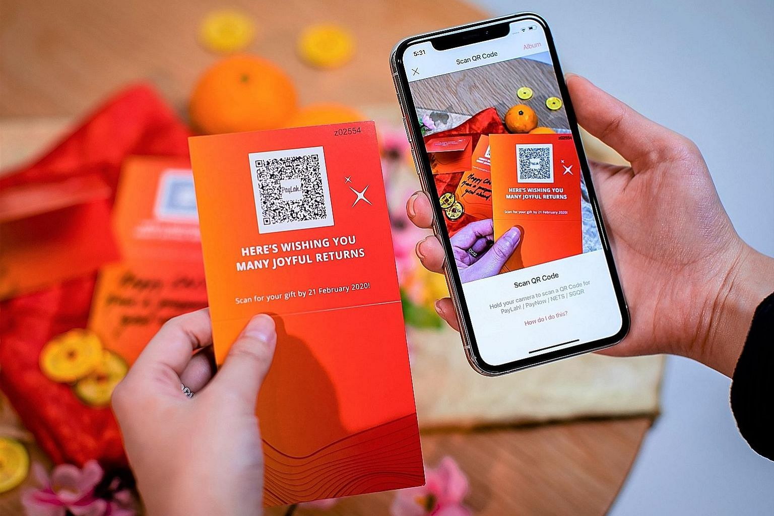 DBS QR Gift allows DBS PayLah! users to scan a QR code to load a cash value into gift cards. Recipients have to be PayLah! or PayNow users.