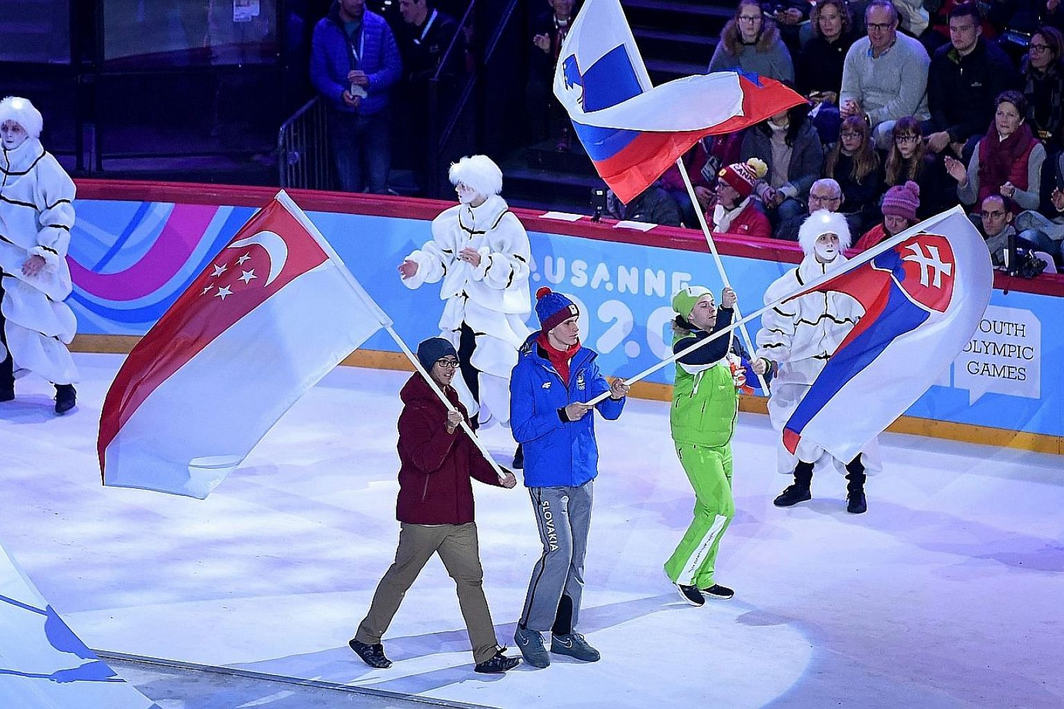 The Winter Youth Olympic Games began in Lausanne, Switzerland, on Thursday, with ice hockey player Matthew Hamnett (far left) representing Singapore at the opening ceremony at the Vaudoise Arena. Two other Singaporeans, short track speed skaters Alys
