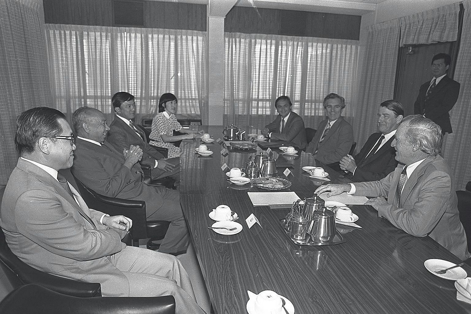 Dr Goh Keng Swee (second from left) and then GIC managing director Yong Pung How (far left) meeting then New South Wales Premier Neville Wran (second from right) and his team in 1982. When Dr Goh approached Mr Yong to helm GIC, Mr Yong was startled,