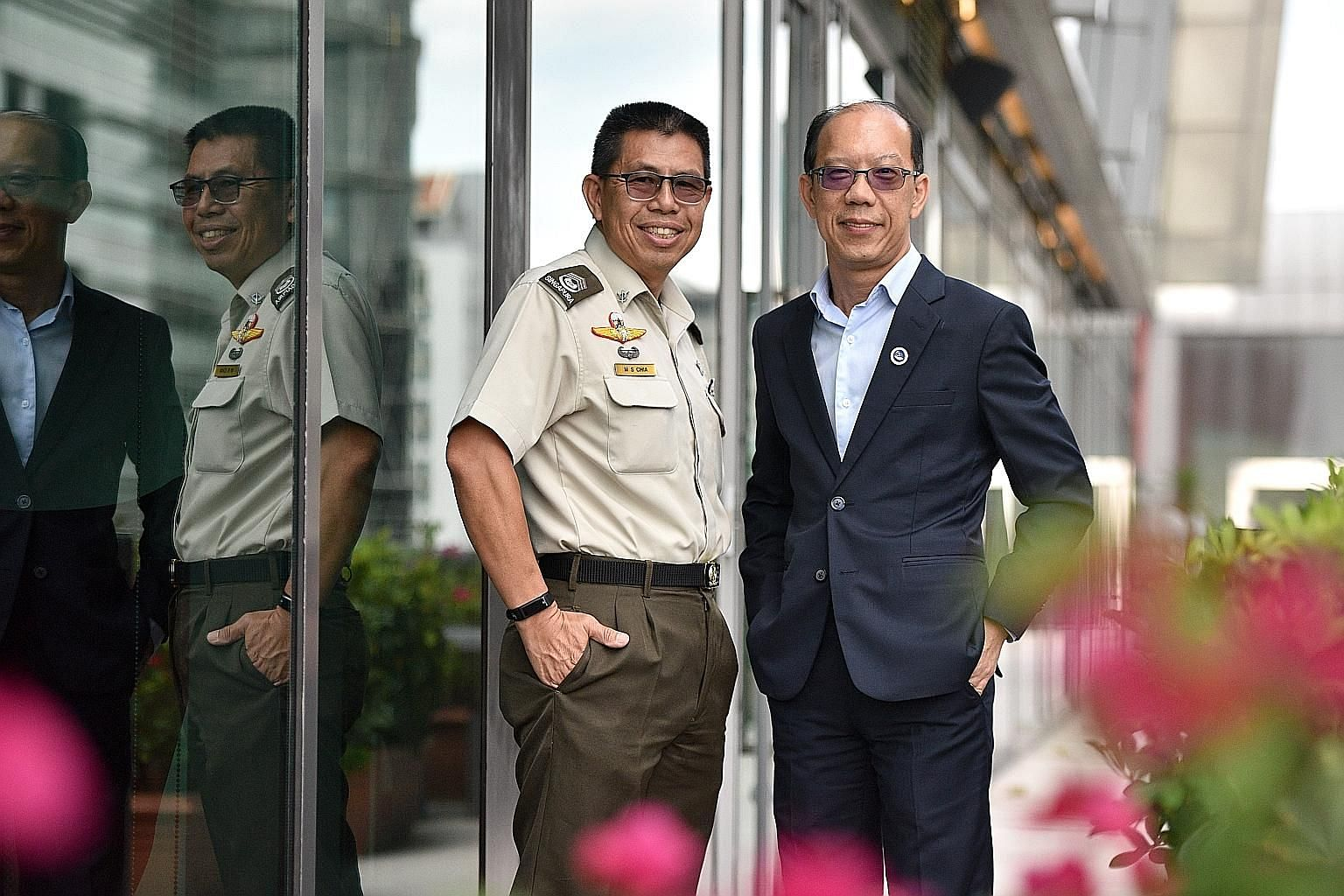 Master Warrant Officer Chia Mui Sowe (left), 54, and Colonel (Retired) Lai Hing Nam, 53, are recipients of the bond-free Singapore Management University Warriors Scholarship.