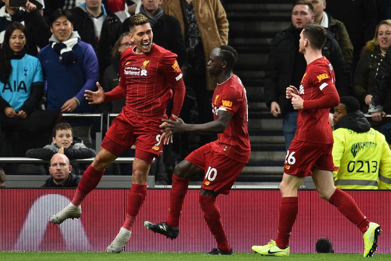 Roberto Firmino celebrating after scoring Liverpool's first-half winner against Tottenham on Saturday. It was his seventh league goal this season, all coming in away games.