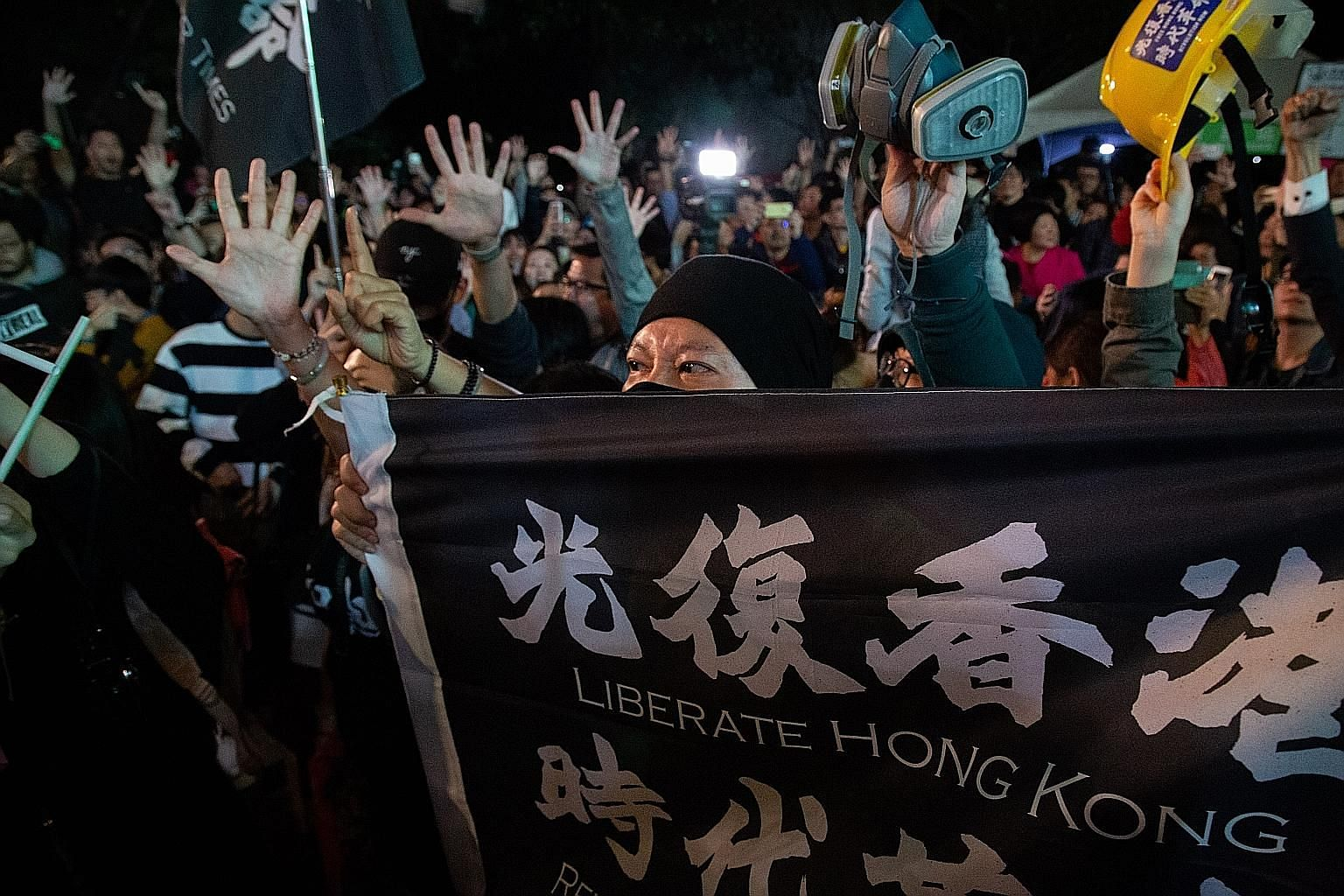 An attendee holding a flag in support of Hong Kong at a rally of Taiwan President Tsai Ing-wen's Democratic Progressive Party in Taipei on Saturday. PHOTO: BLOOMBERG