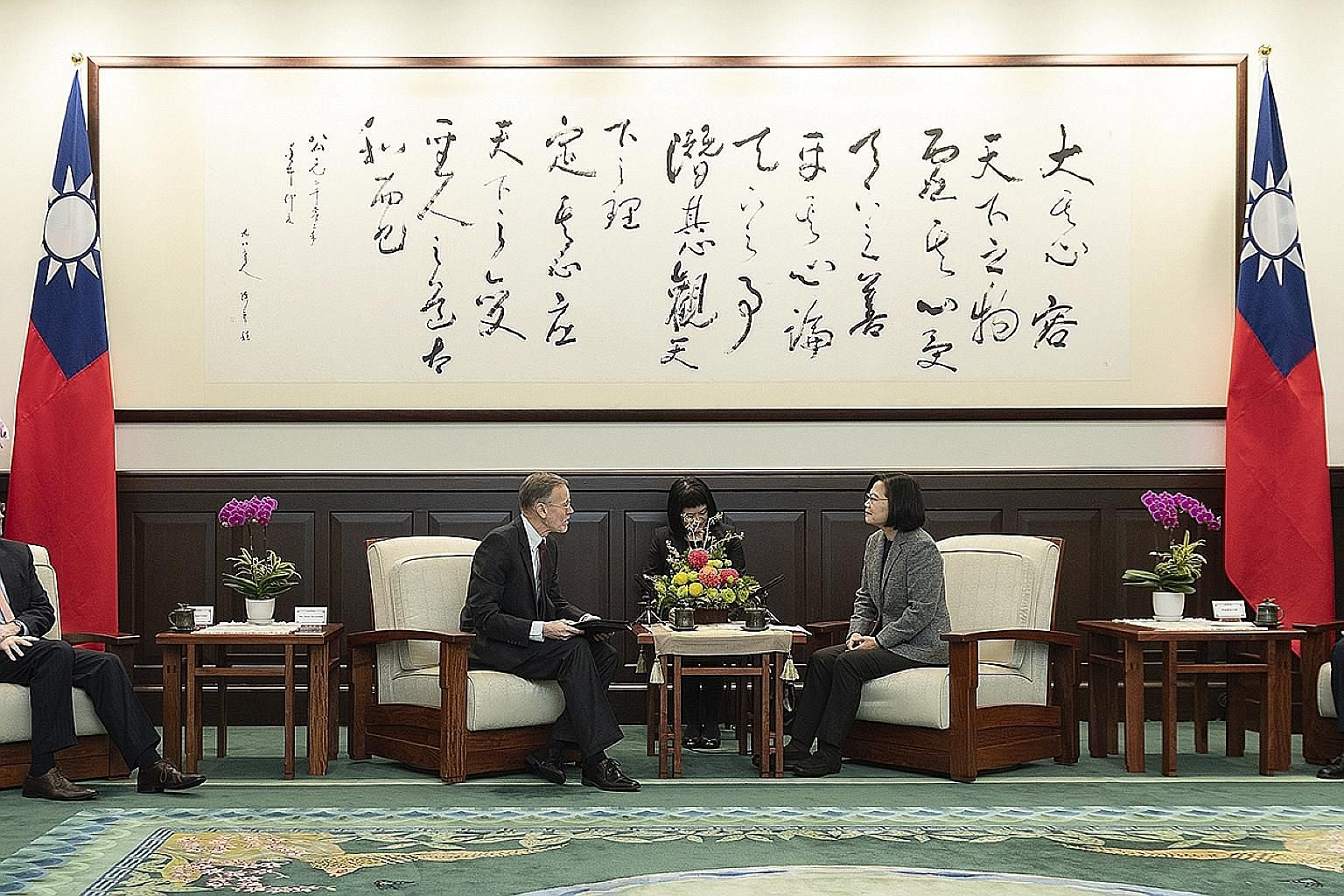 Taiwan President Tsai Ing-wen meeting director of the American Institute in Taiwan William Brent Christensen yesterday, a day after her landslide election victory. While Ms Tsai was widely expected to win, the margin of her victory was fuelled by bot