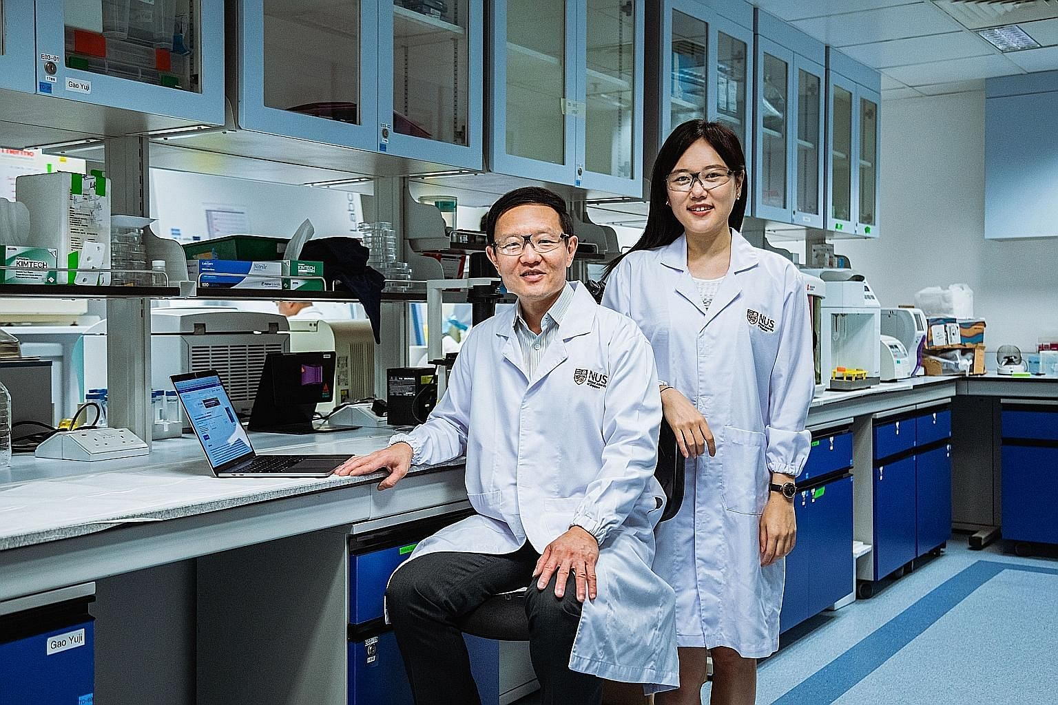 Professor Lim Chwee Teck (left) from the National University of Singapore's Department of Biomedical Engineering and recent PhD graduate Lim Su Bin developed a tool that can be used together with liquid biopsies to diagnose lung cancer and predict ho