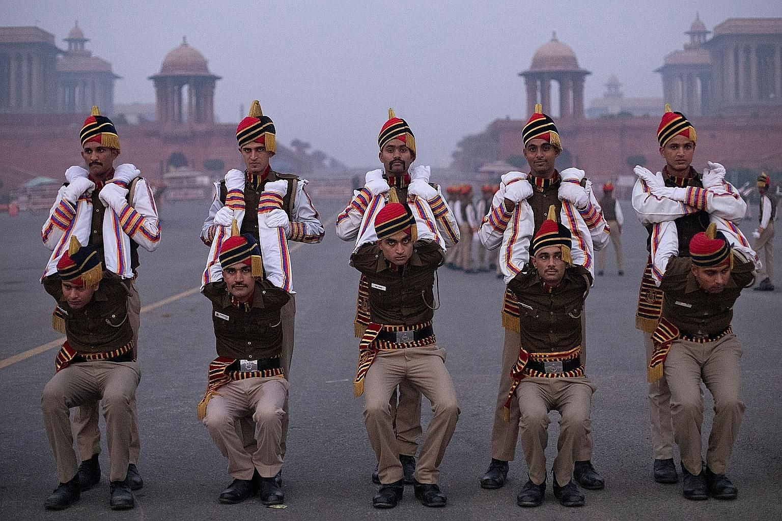 Members of the Delhi Police stretching before a Republic Day parade rehearsal in New Delhi yesterday morning. The police are among the various contingents from different forces preparing for the event. India celebrates Republic Day on Jan 26, to comm