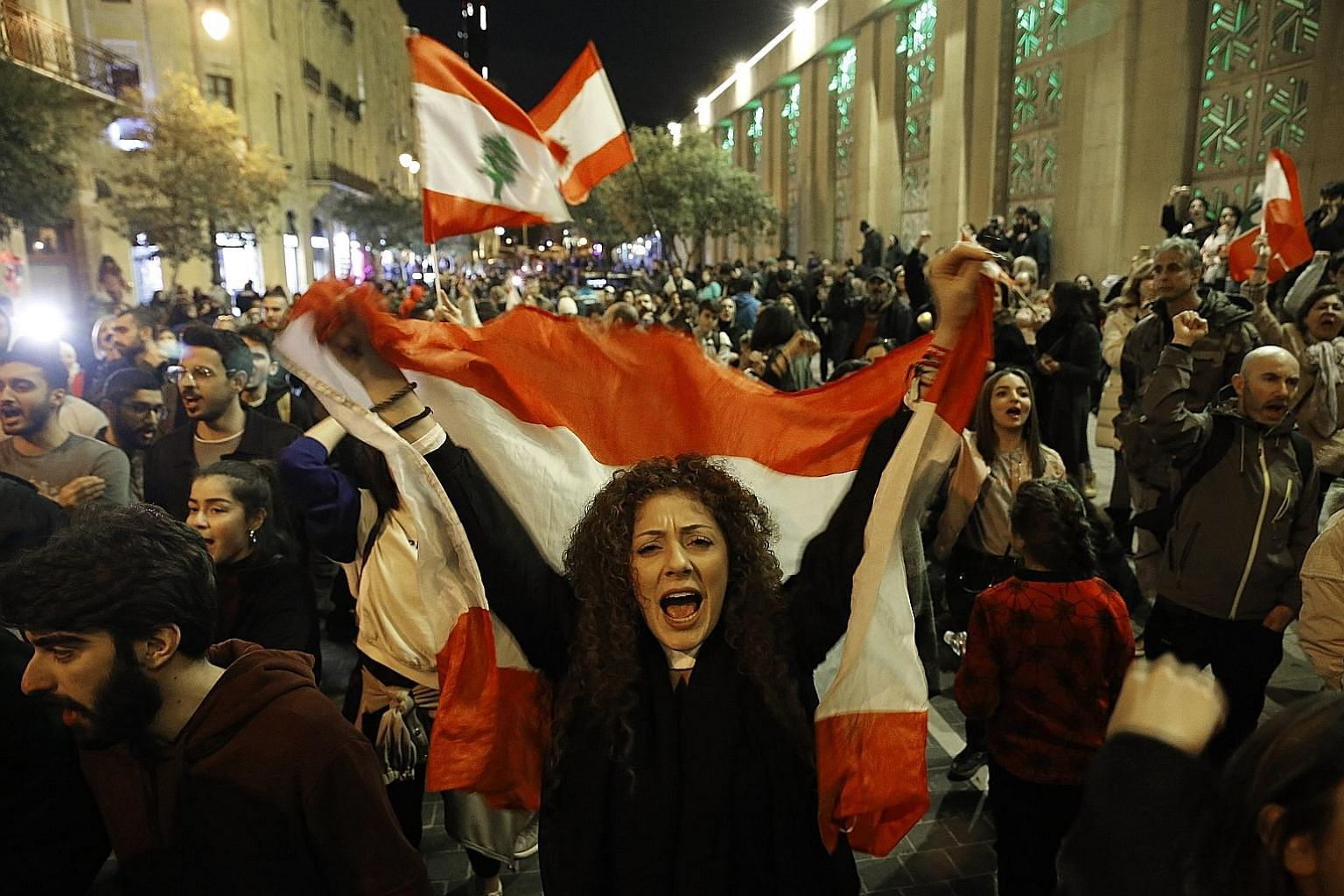 Above: Protesters in Beirut, Lebanon, last Saturday, demanding an end to widespread corruption and mismanagement by the political class. The sudden eruption of mass protests in various parts of the world is a negative development, says the writer. Be