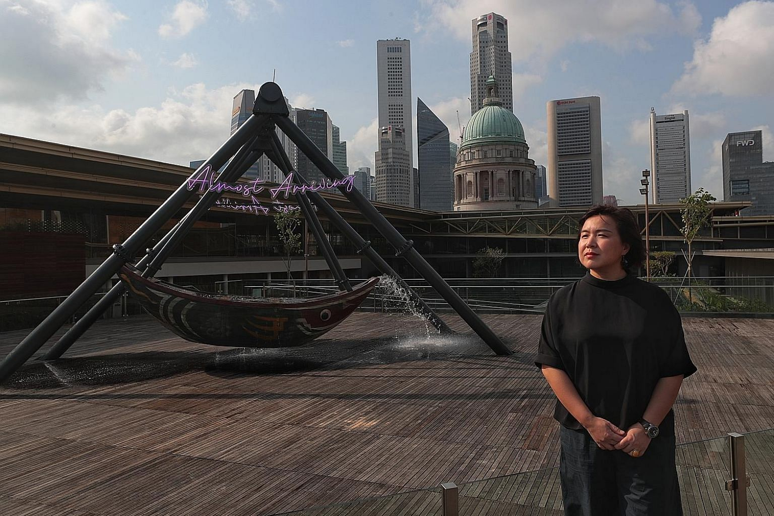 Beijing-based artist Cao Fei with the 5m-tall installation, Fu Cha, on the roof of the National Gallery Singapore.