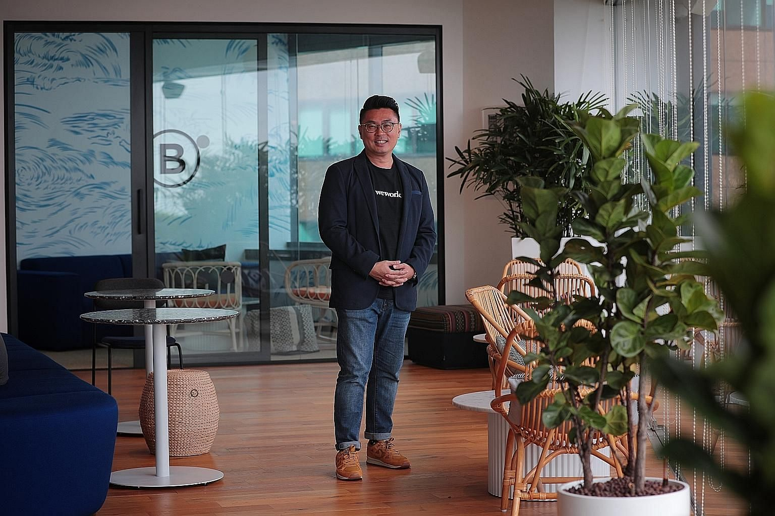 Mr Turochas Fuad at WeWork's office in Battery Road. The managing director for the region said that the regional arm intends to continue expanding into new office spaces in Singapore and the rest of South-east Asia.