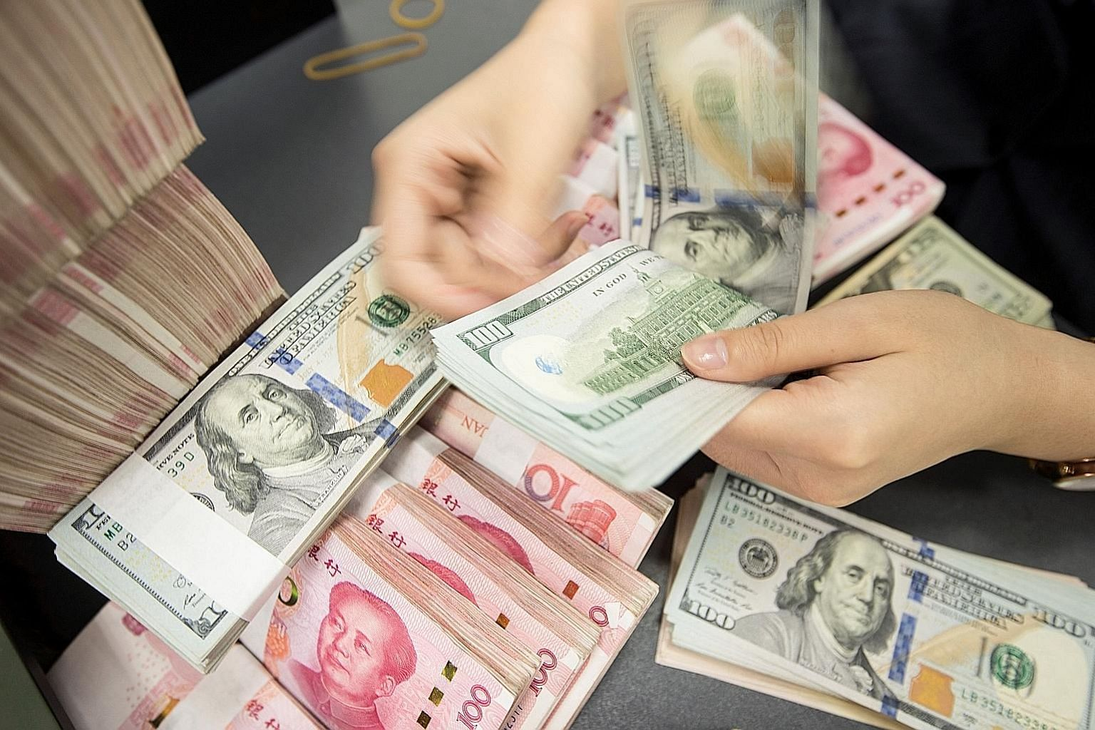 """The US Treasury Department said the phase one deal requires """"structural reforms and other changes to China's economic and trade regime in several key areas, including currency and foreign exchange issues"""". PHOTO: AGENCE FRANCE-PRESSE"""