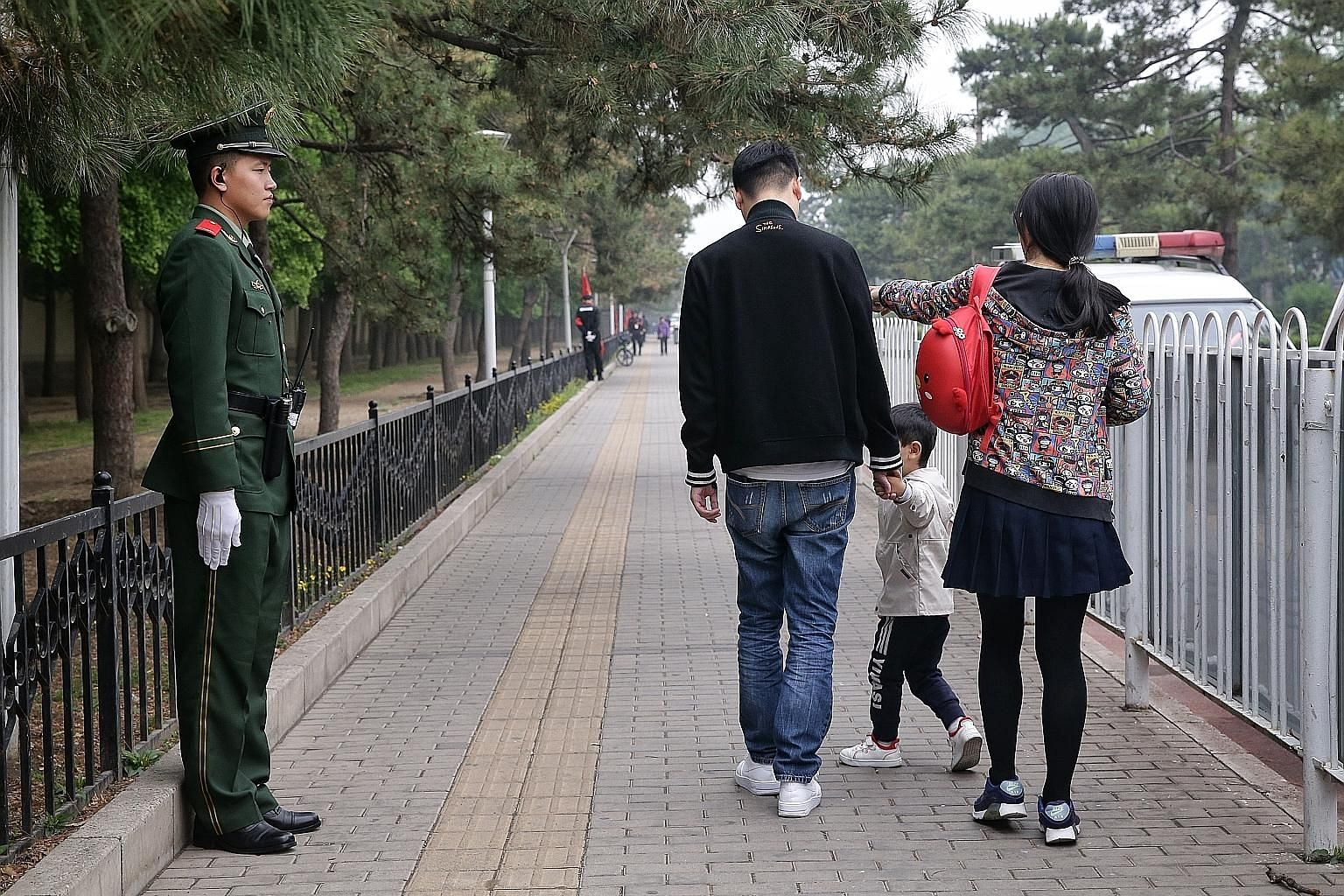 A couple and their child in Beijing. According to the latest World Population Prospects from the United Nations, 27 countries have fewer people now than in 2010, and it expects 55 nations - including China - to experience declines between now and 205