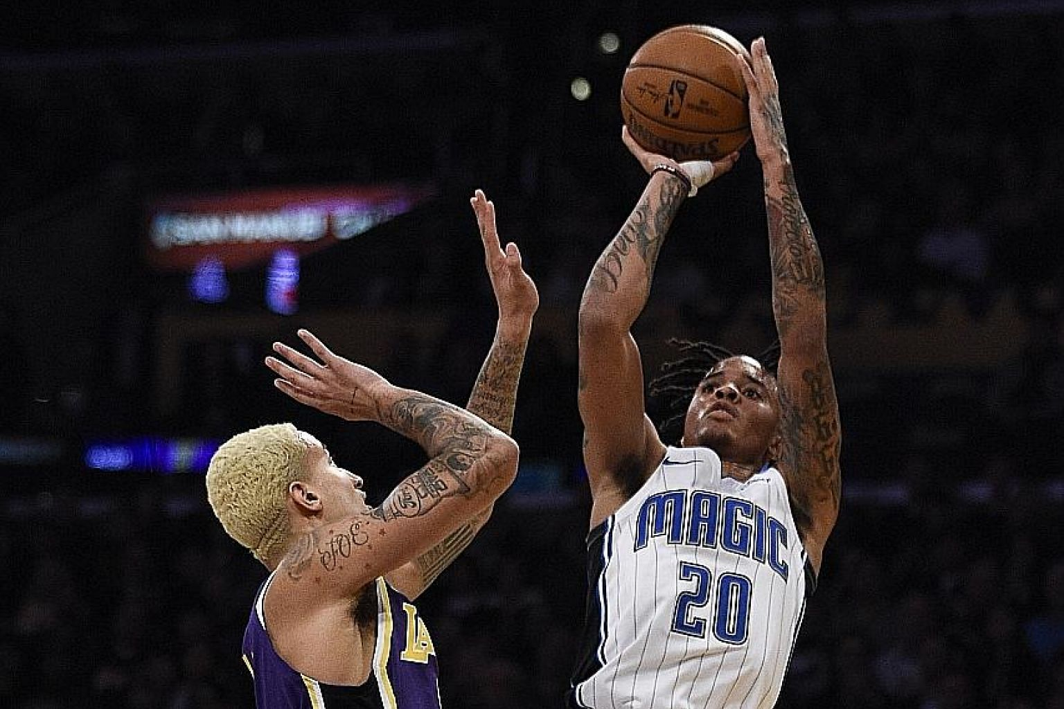 Magic guard Markelle Fultz shooting over Lakers forward Kyle Kuzma at the Staples Centre on Wednesday. The No. 1 draft pick in 2017 showed what he is capable of by finishing with 21 points, 11 rebounds and 10 assists. PHOTO: REUTERS