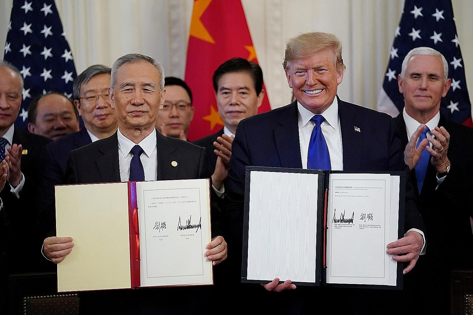 Chinese Vice-Premier Liu He and US President Donald Trump after signing phase one of the trade deal between their countries in Washington on Wednesday. The deal had China committing to buy another US$200 billion (S$269 billion) of US goods and servic