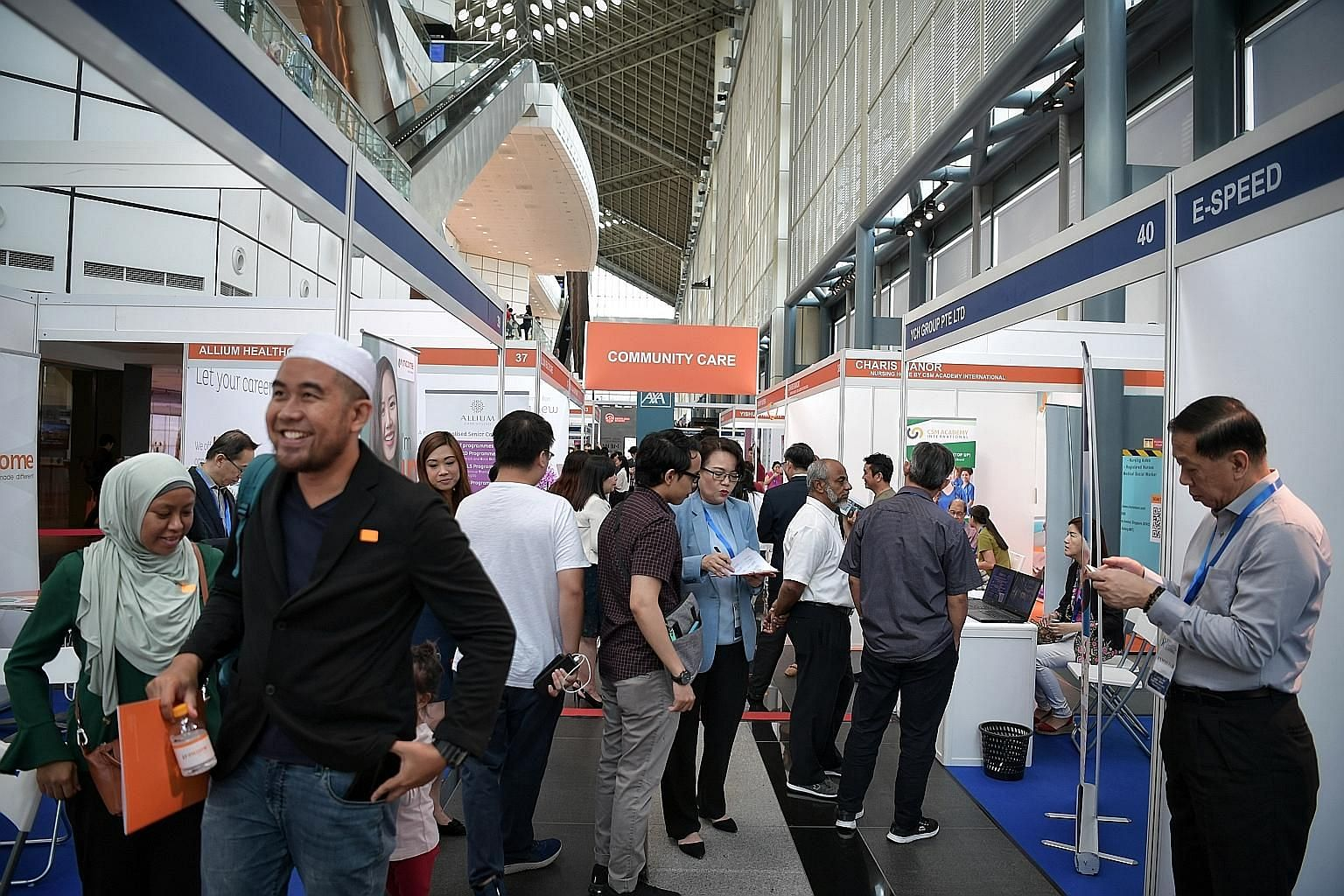 The ST Jobs Career and Learning Fair last year. Changes to the Fair Consideration Framework will nudge employers to reconsider their hiring strategies, driving up competition for local workers, according to academics and human resources experts.
