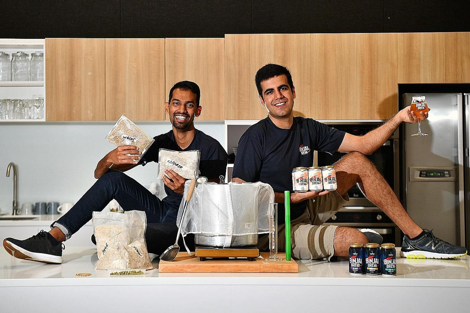 Mr Rahul Immandira, (left) and Mr Heetesh Alwani, co-founders of Binjai Brew, have found a way to make beer more earth-friendly. Their new beer, Set B, is made with orange peel from juice machines and unwanted bread crusts from a Whampoa bakery. The