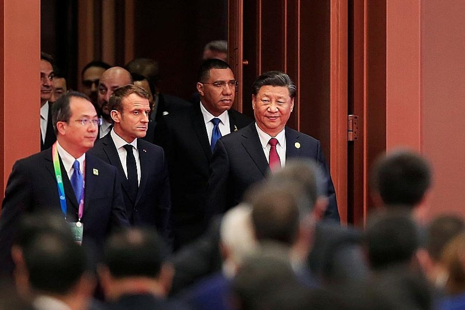 Chinese President Xi Jinping with French President Emmanuel Macron and others at the China International Import Expo in Shanghai on Nov 5 last year. While it may look like China has had to make more concessions for the US-China phase one deal, it cou