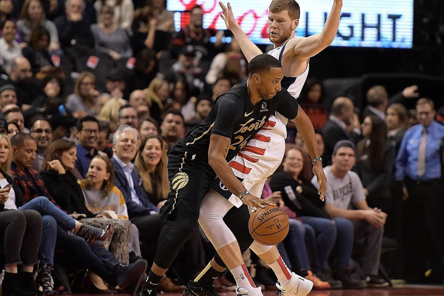 Toronto's Norman Powell trying to dribble past Washington Wizards' Davis Bertans during their NBA game on Friday. The guard led the Raptors with 28 points in the convincing 140-111 victory.