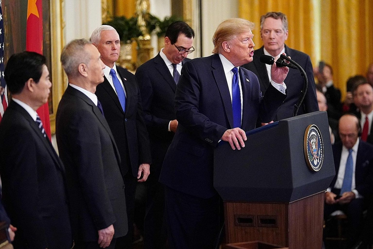 US President Donald Trump and China's Vice-Premier Liu He (second from left) holding a press conference in the White House in Washington, before they sign the phase one trade deal on Wednesday. Talks on a phase two deal will begin immediately, says U