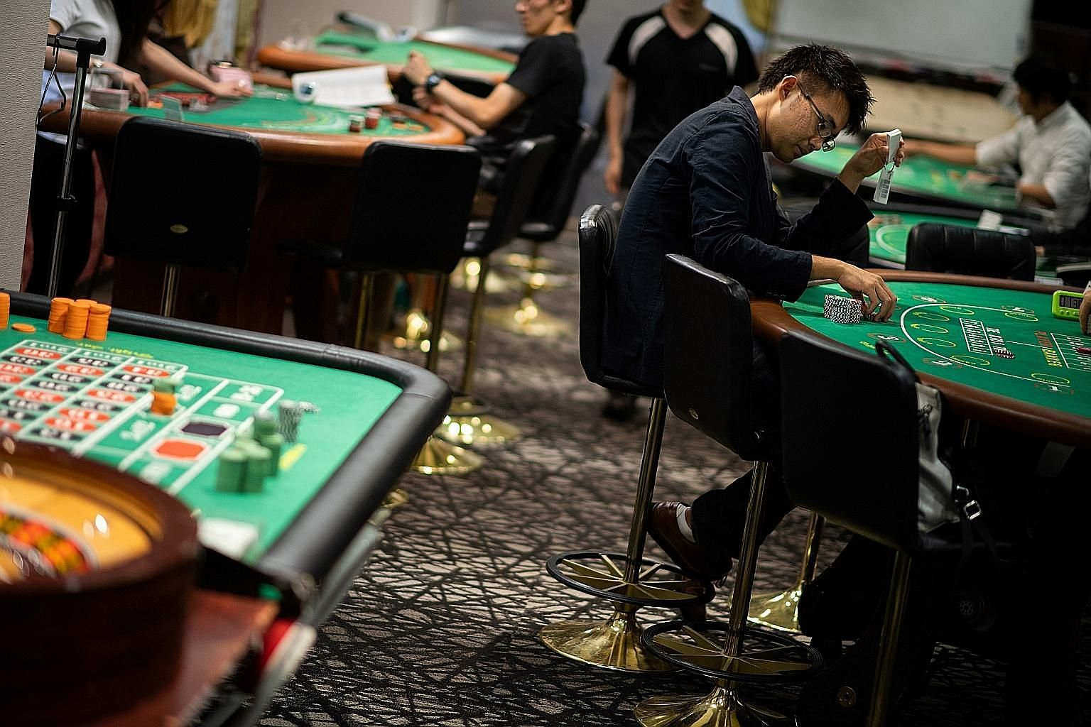 Students at the Japan Casino School in Tokyo in June 2018. There are concerns that casinos will worsen social issues such as problem gambling and fuel the rise of mafia groups. The bribery scandal has exposed underlying vested interests that have unn