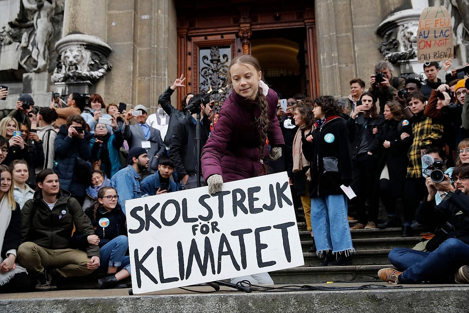 """Greta Thunberg holding a placard that says """"School strike for climate"""" during a rally in Lausanne, Switzerland, last Friday. The Swedish climate campaigner joined several thousand protesters in the Swiss city days before the start of the Davos summit"""