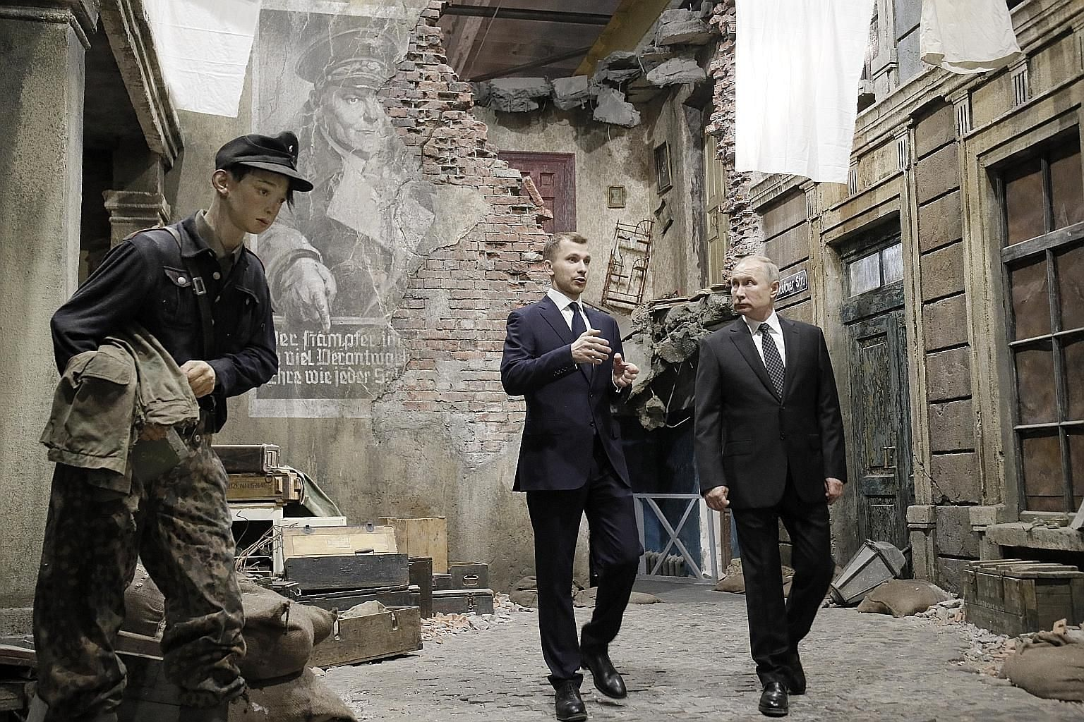 """President Vladimir Putin visiting the 3D panorama """"Memory Speaks. The Road Through The War"""" exhibition in Saint Petersburg last Saturday. He says a transition plan for Russia is crucial."""