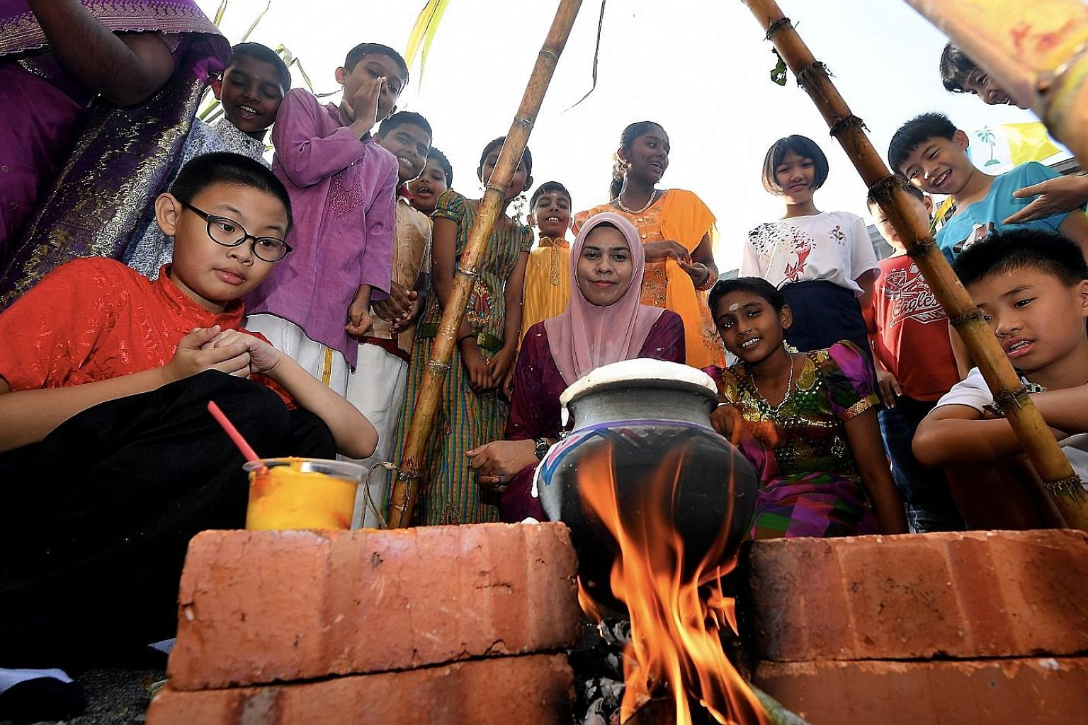 Students and staff of a school in Penang during Pongal celebrations last Friday. The Tamil festival was at the centre of recent race-baiting issues in which the Malaysian Cabinet had to intervene.