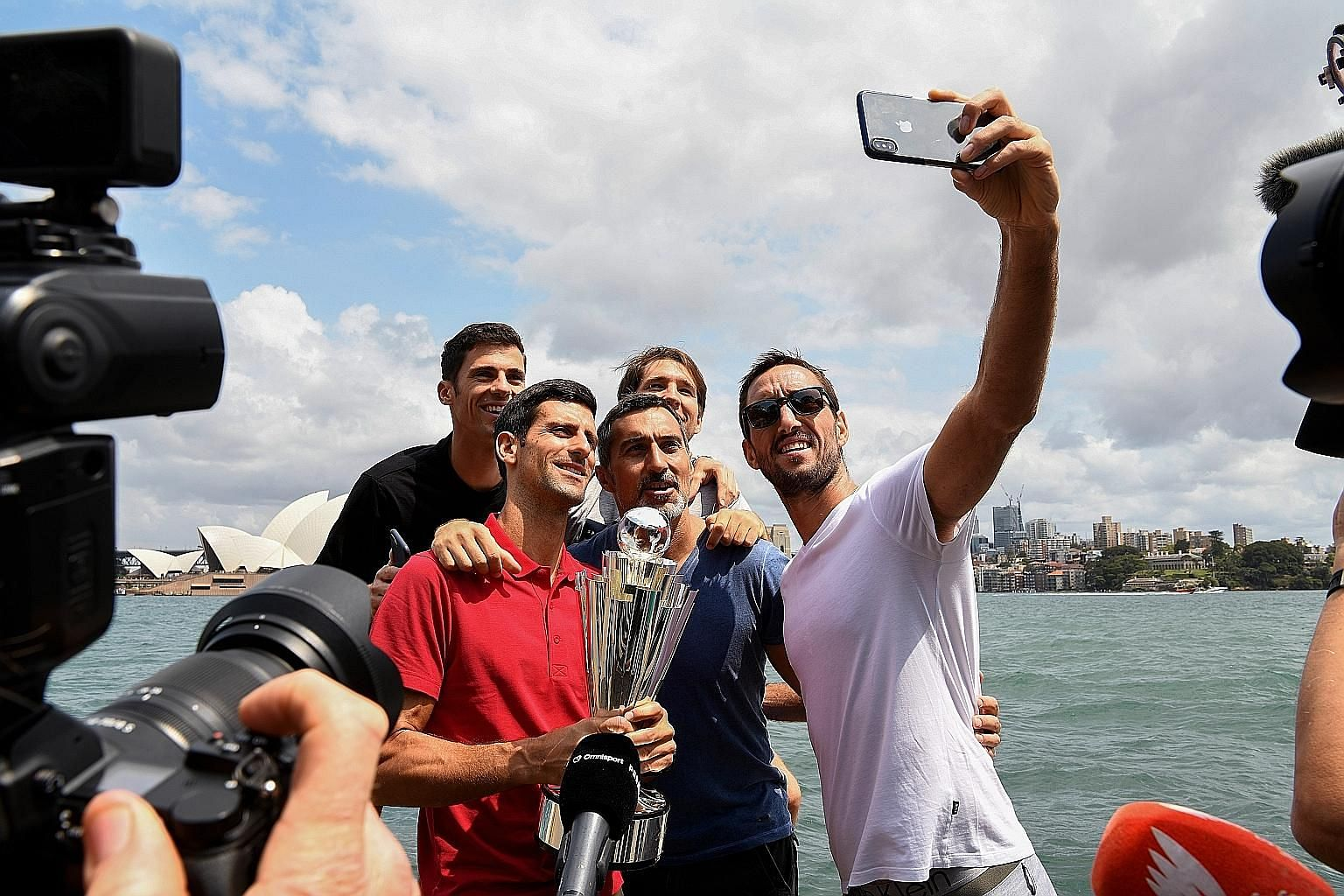 Novak Djokovic (in red) and the rest of the Serbia team posing for a wefie with the ATP Cup in Sydney. Australia has been a happy hunting ground for the 32-year-old.