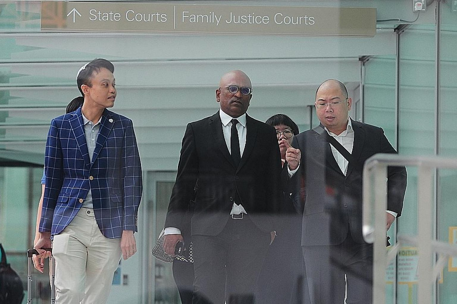 (From left) Daniel De Costa, lawyer M. Ravi and editor of TOC Terry Xu outside the State Courts yesterday. District Judge Christopher Tan, after hearing the case yesterday, said there was no novel question of law in the case that warranted a referral