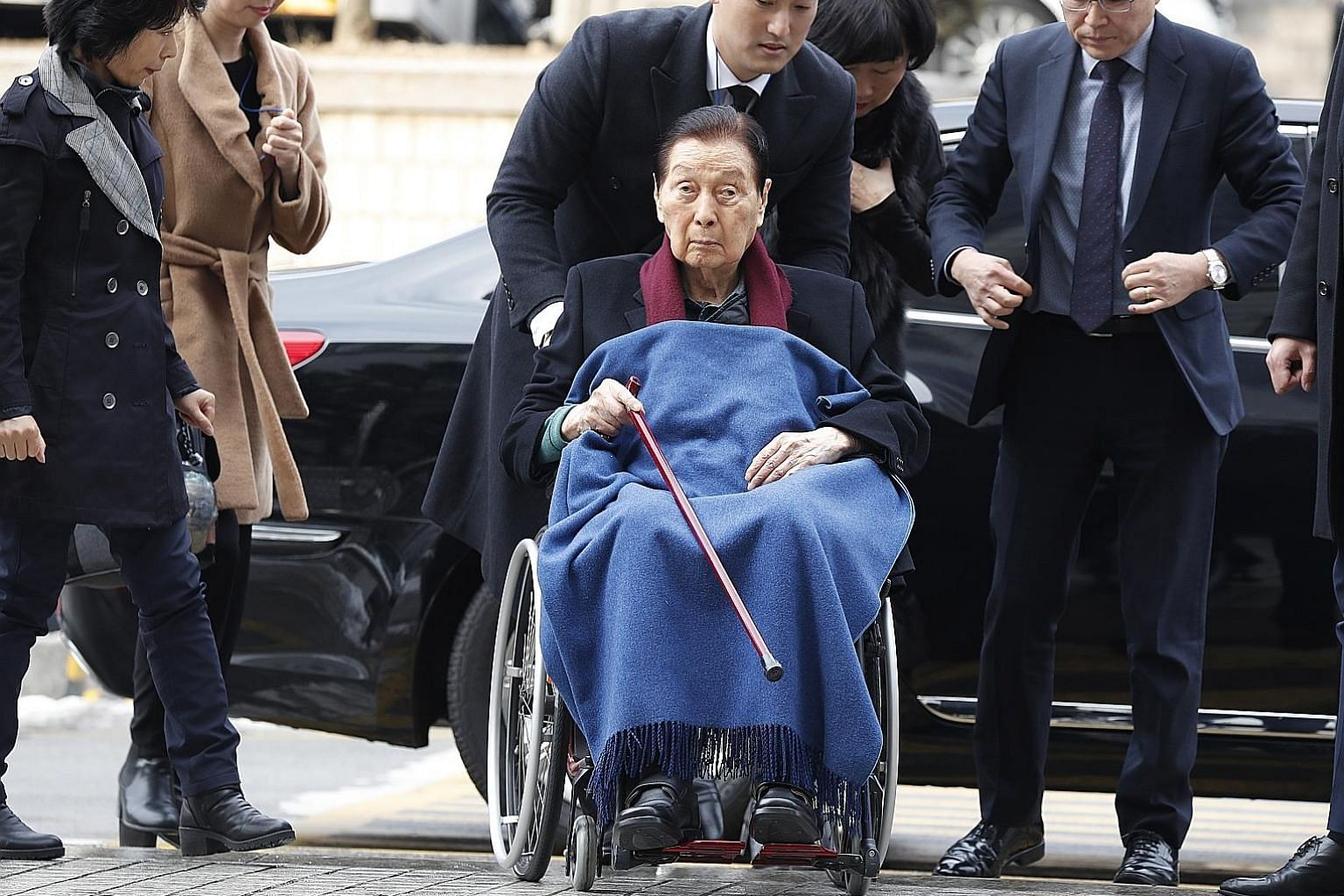 Lotte Group founder Shin Kyuk-ho (centre), who died on Sunday at 97, never established a clear heir apparent, the writer says. Five years ago, Mr Shin's two sons were already jockeying for power as their father's health declined.