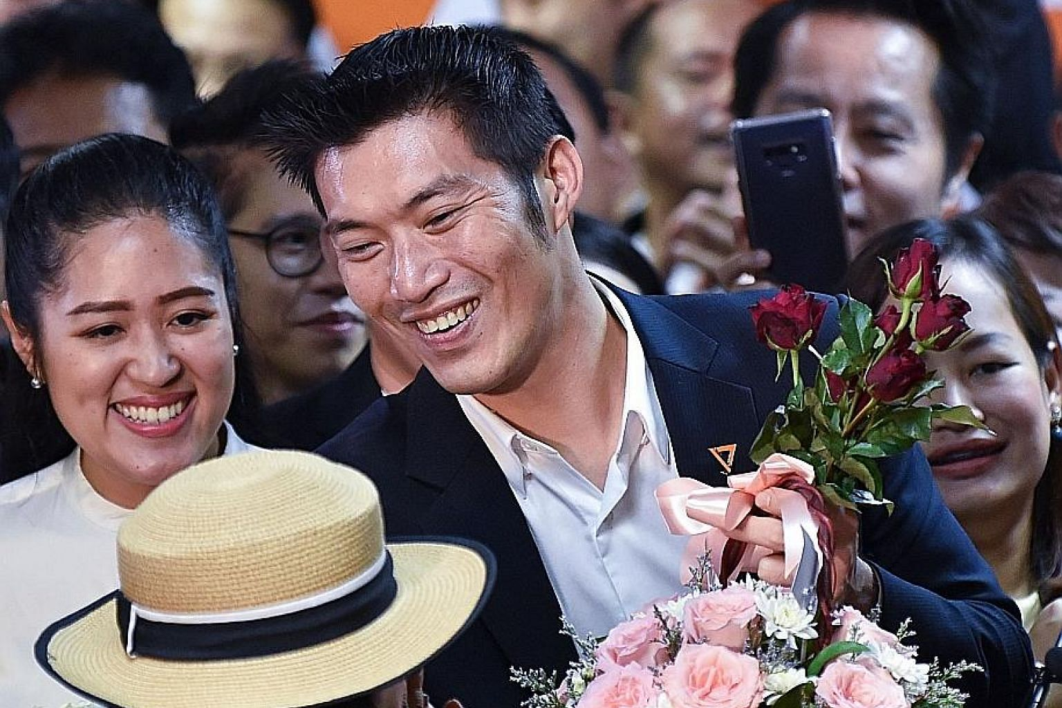 Future Forward's founder Thanathorn Juangroongruangkit greeting supporters in Bangkok yesterday, after Thailand's Constitutional Court found it not guilty of seeking to overthrow the constitutional monarchy. PHOTO: AGENCE FRANCE-PRESSE