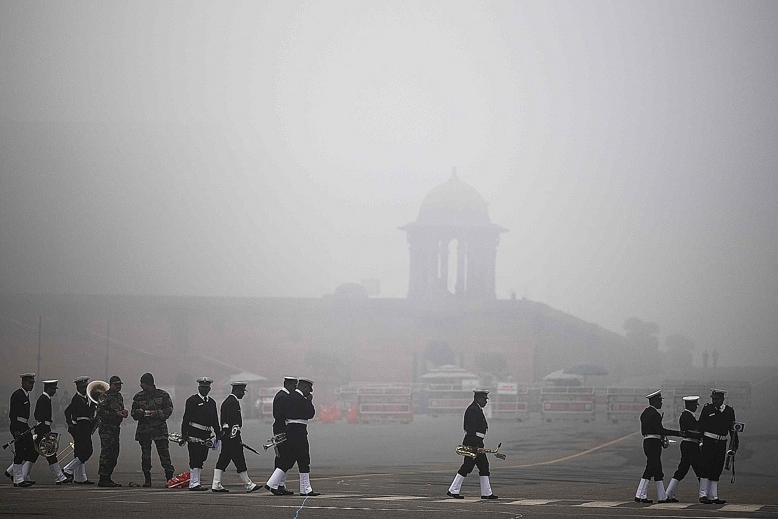The navy band preparing to rehearse for the Republic Day Parade near the Presidential Palace in smog-covered Delhi yesterday.