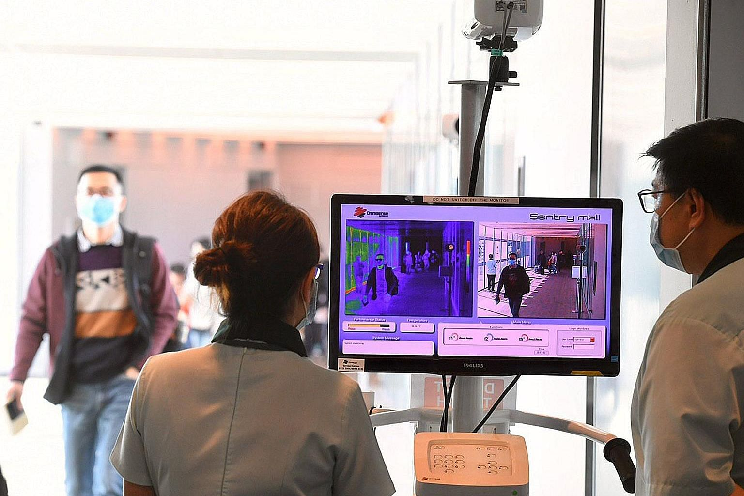 A thermal scanner in use at Changi Airport Terminal 3 yesterday. Temperature screening at the airport has been expanded to cover all inbound travellers on flights arriving from China.