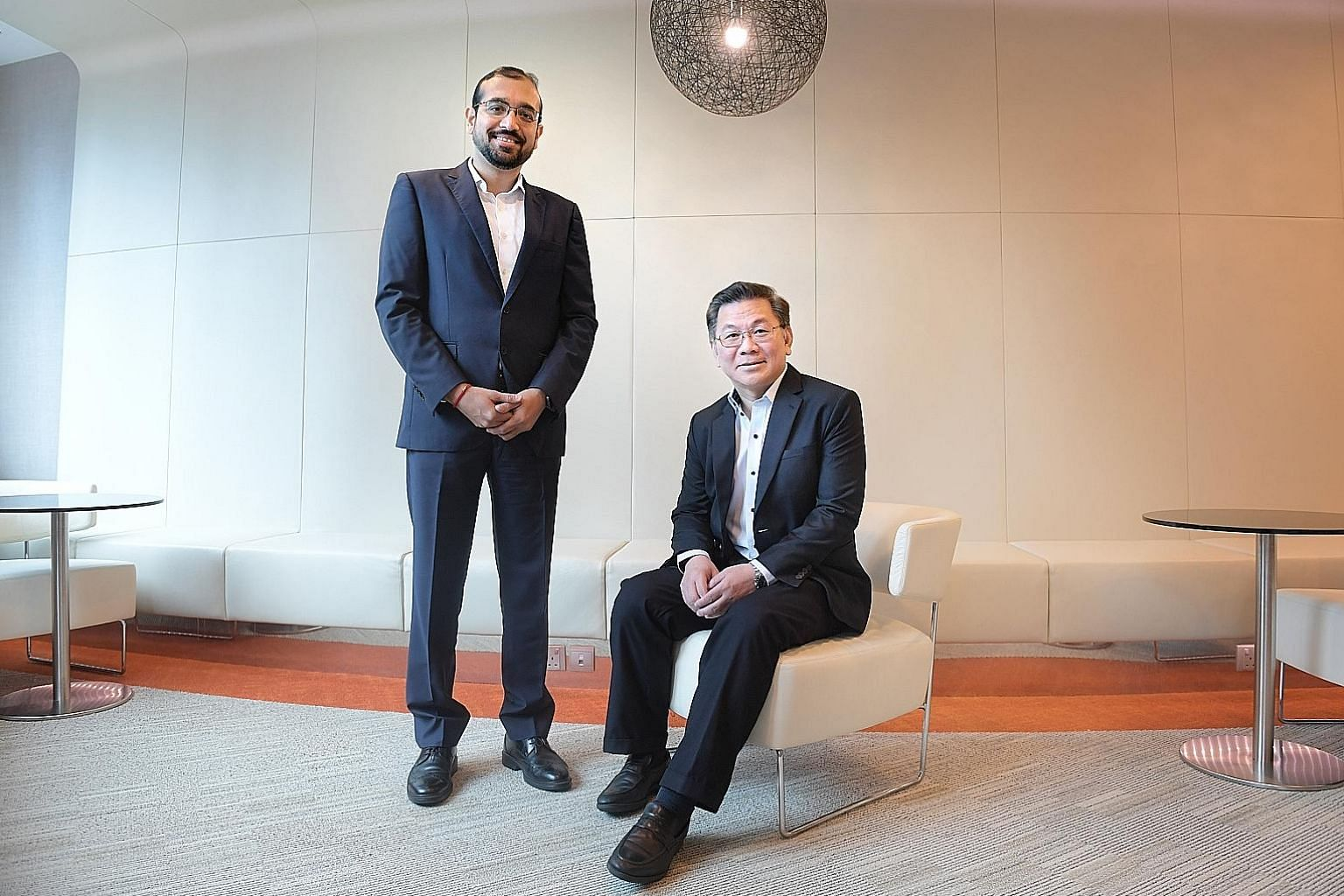 KPMG Singapore deputy head of tax Ajay Kumar Sanganeria (far left) and head of tax Tay Hong Beng. A KPMG report proposed that the range of schemes for business transformation could be made into a comprehensive package that caters to firms at differen