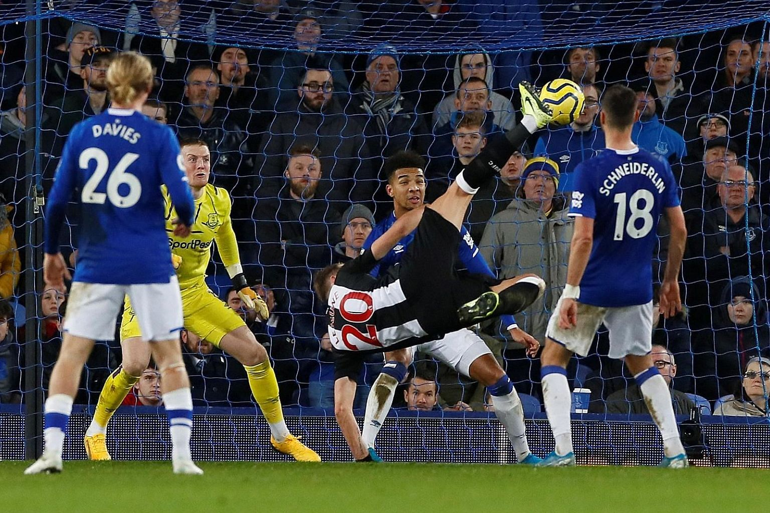 Newcastle centre-back Florian Lejeune scoring his first goal in three years. Just 102 seconds later, he netted against Everton again. PHOTO: REUTERS