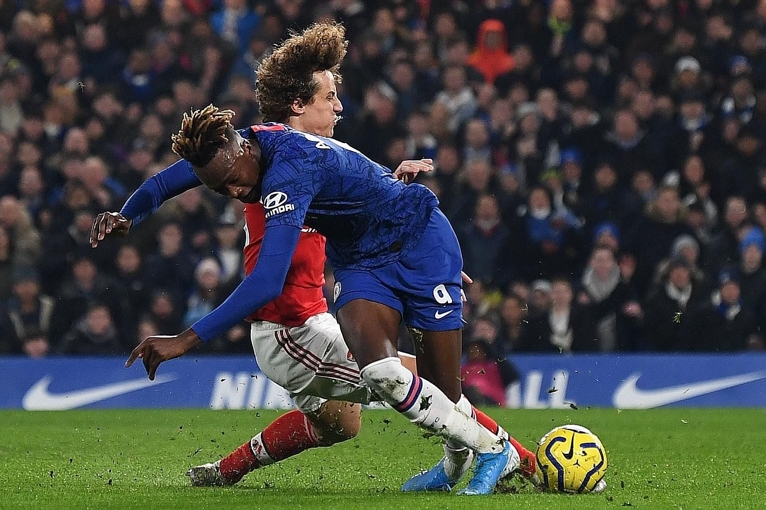Arsenal defender David Luiz fouling Chelsea striker Tammy Abraham to concede a penalty and earn a red card on his return to Stamford Bridge on Tuesday night. Jorginho put the Blues in the lead from the spot but the Gunners equalised twice in the 2-2