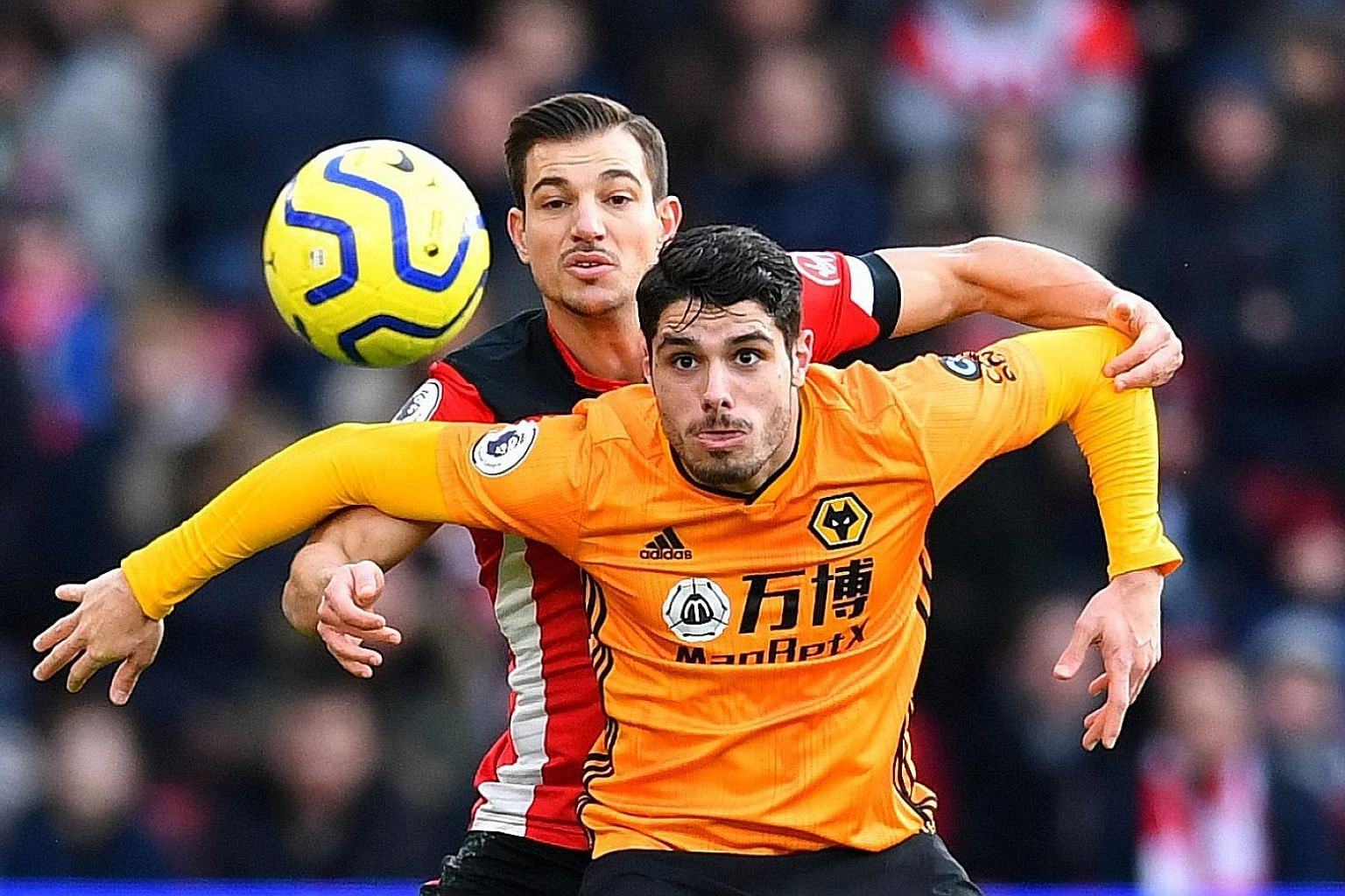 Wolves' Pedro Neto shielding the ball from Southampton's Cedric Soares during Wolves' 3-2 Premier League victory last Saturday. Sixth-placed Wolves have only five league losses so far. PHOTO: REUTERS