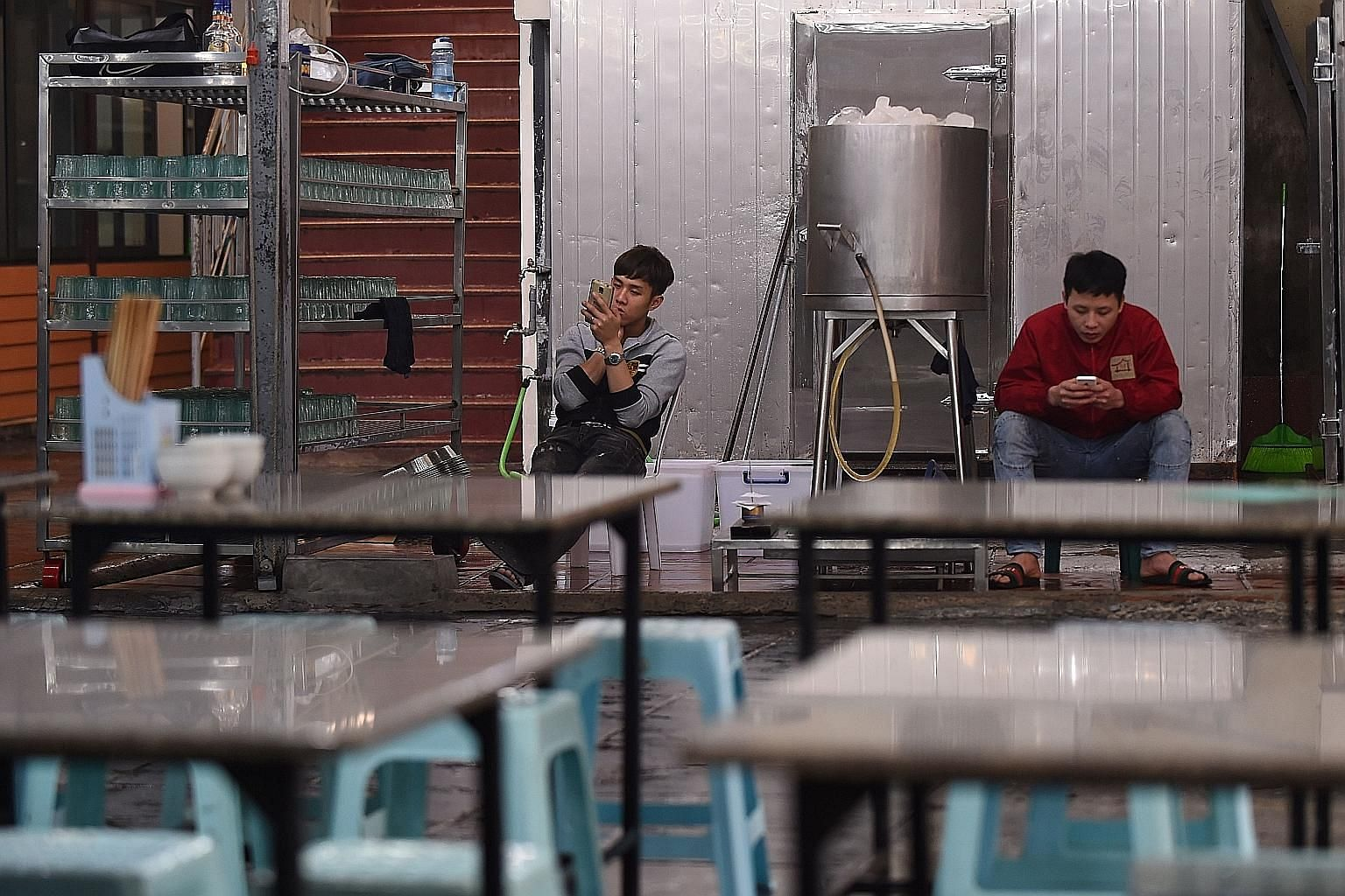Service staff waiting for customers at a Hanoi bar yesterday. A tough new drink-driving law is part of an effort to change the drinking culture in Vietnam, one of the world's fastest-growing markets for beer. PHOTO: AGENCE FRANCE-PRESSE