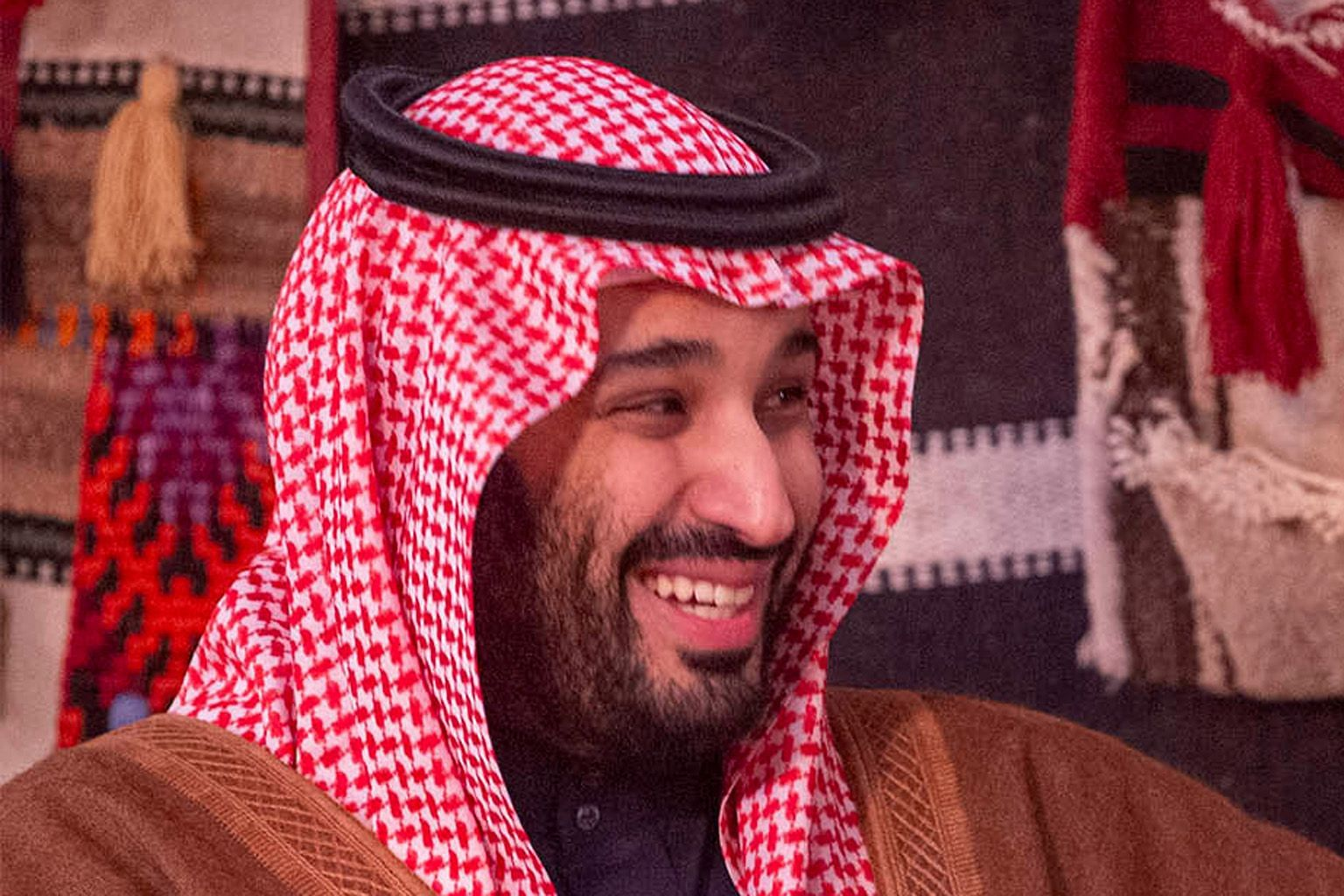 Saudi Arabia's Crown Prince Mohammed bin Salman has been linked to a report suggesting the kingdom is involved in the hacking of a phone used by Amazon boss Jeff Bezos, seen here with his girlfriend Lauren Sanchez.