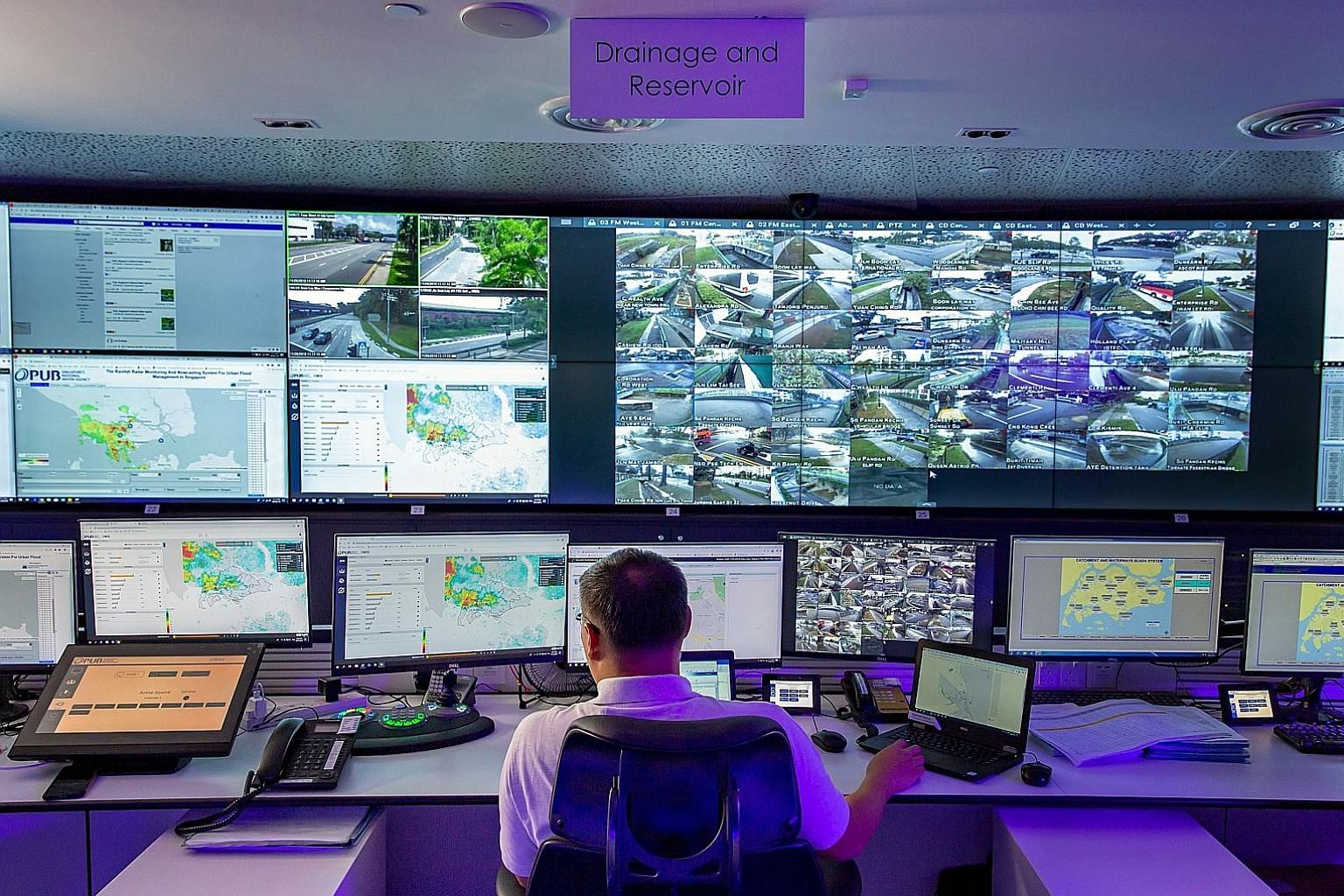 Left: The PUB's Joint Operations Centre in Scotts Road, where duty officers monitor the rainfall prediction system, as well as a network of CCTVs and water level sensors located in drains and canals. Below: The X-band radar at Changi Water Reclamatio