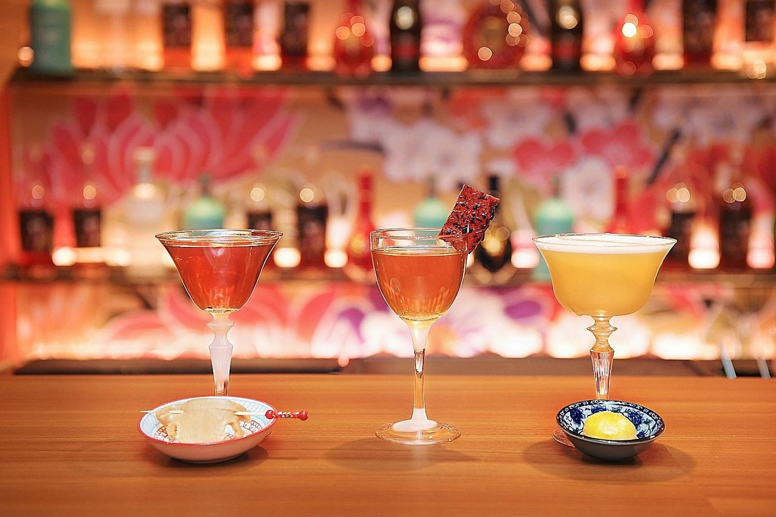 Junior The Pocket Bar's month-long concept, called House of the Dancing Lion, features drinks such as (from left) Guaranteed Abundance, Fanning the Flames and Rolling for Prosperity.