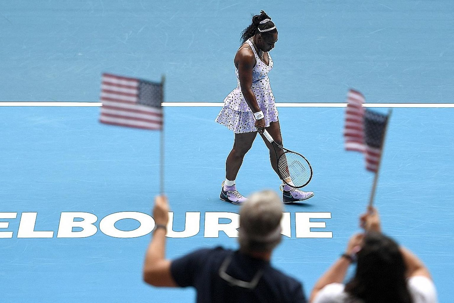 Serena Williams walking forlornly during her Australian Open exit to China's Wang Qiang. The American committed 56 unforced errors.