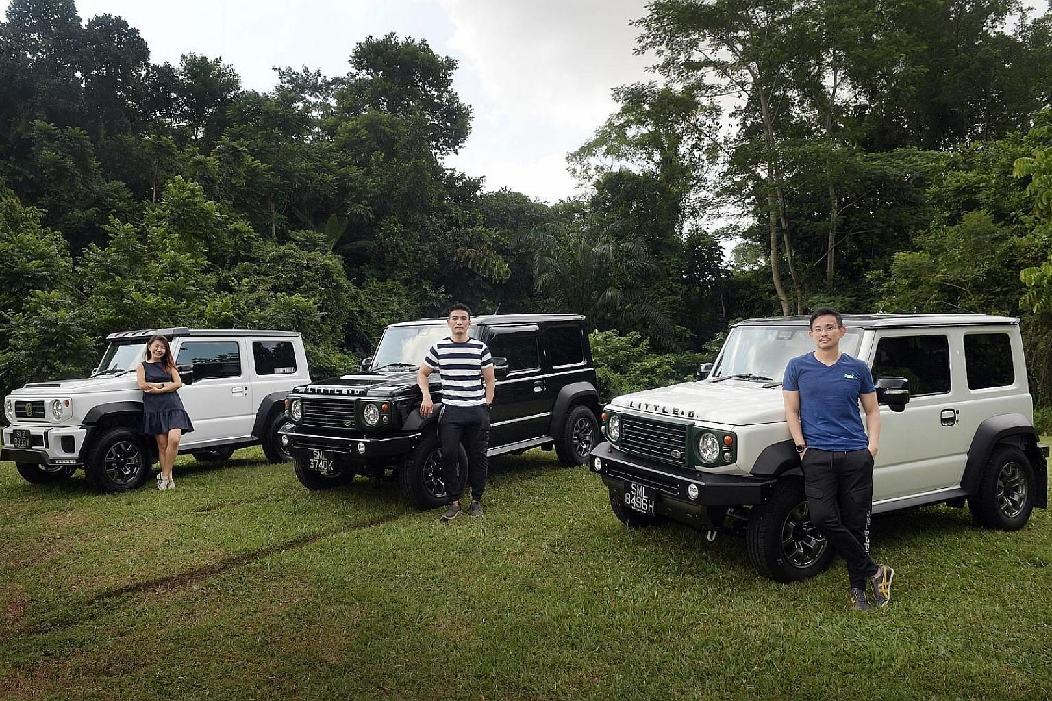 Mr Jerald Koh's (centre) enthusiasm for the Suzuki Jimny rubbed off on his friends, Ms Chloe Lim and Mr William Yeo, who bought their cars from the same parallel importer as he did.
