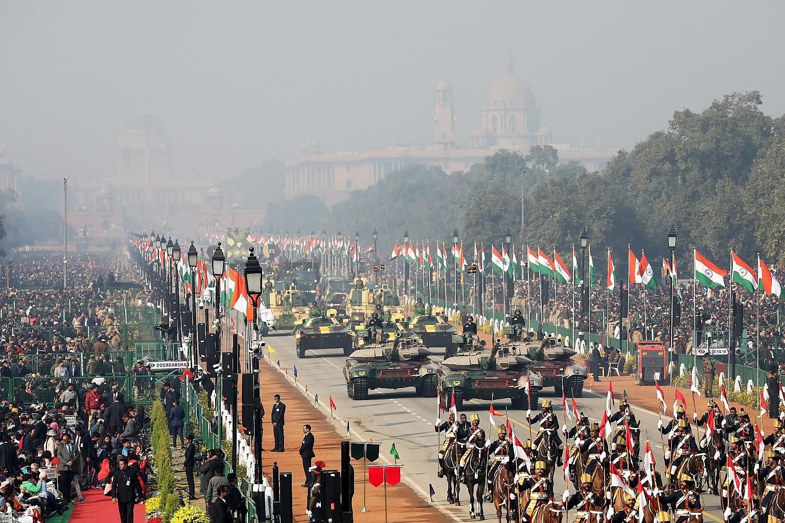 Indian Army tanks moving along the Rajpath boulevard during India's Republic Day parade in New Delhi yesterday. Brazil's President Jair Bolsonaro was the guest of honour at the event, a pomp-filled spectacle of military might featuring army tanks, ho