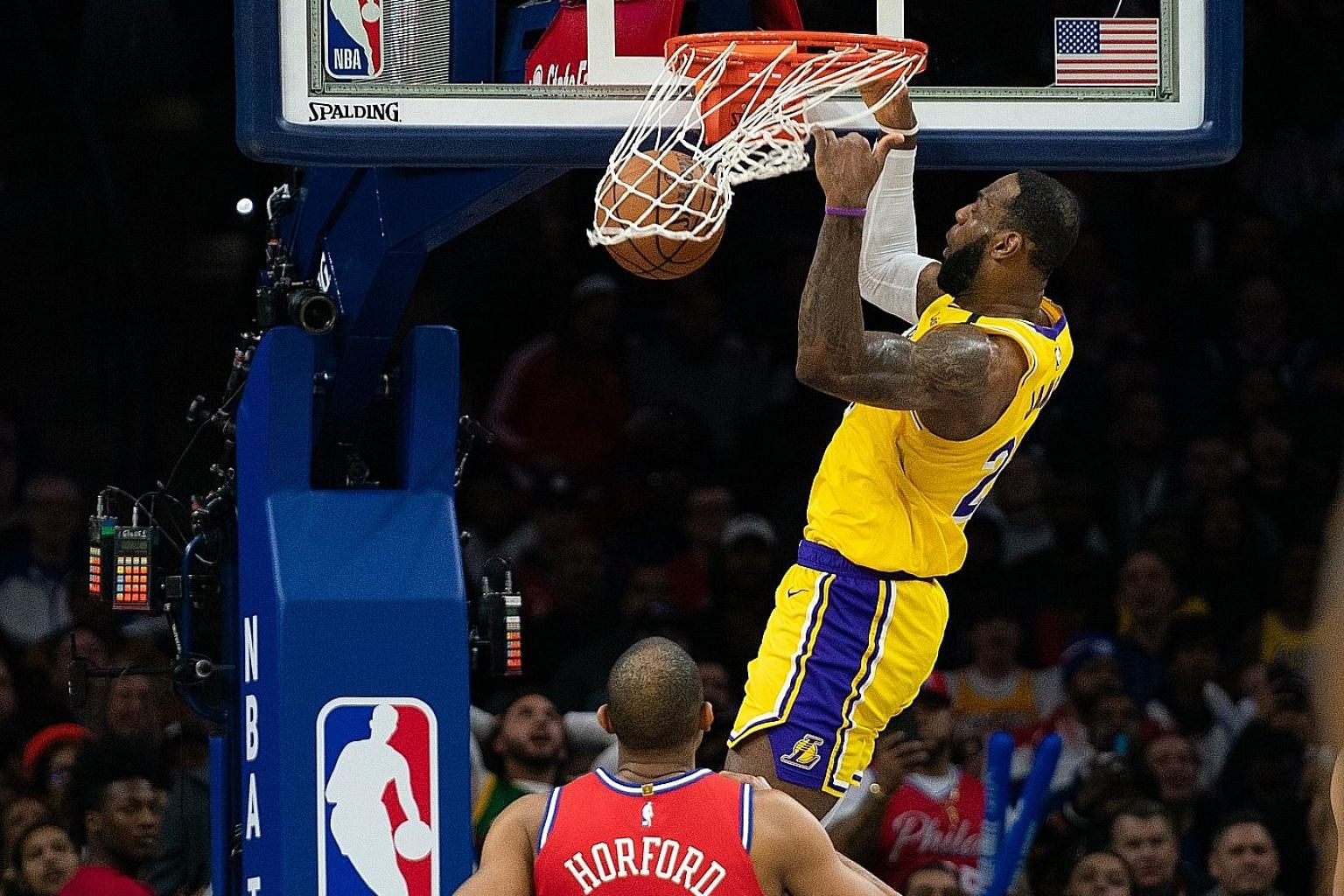 LA Lakers forward LeBron James dunking the ball over Philadelphia 76ers forward Al Horford on the way to his new career total of 33,655 points. The Lakers, however, lost 108-91 in Philadelphia.