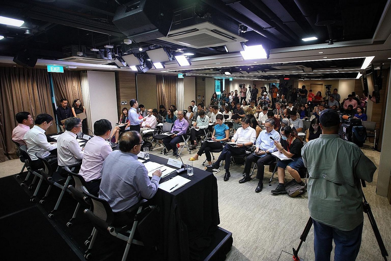 Social and Family Development Minister Desmond Lee (standing) speaking about his ministry's measures at a press conference by the multi-ministry task force on the Wuhan virus yesterday. Seated behind him are (from left) Education Minister Ong Ye Kung
